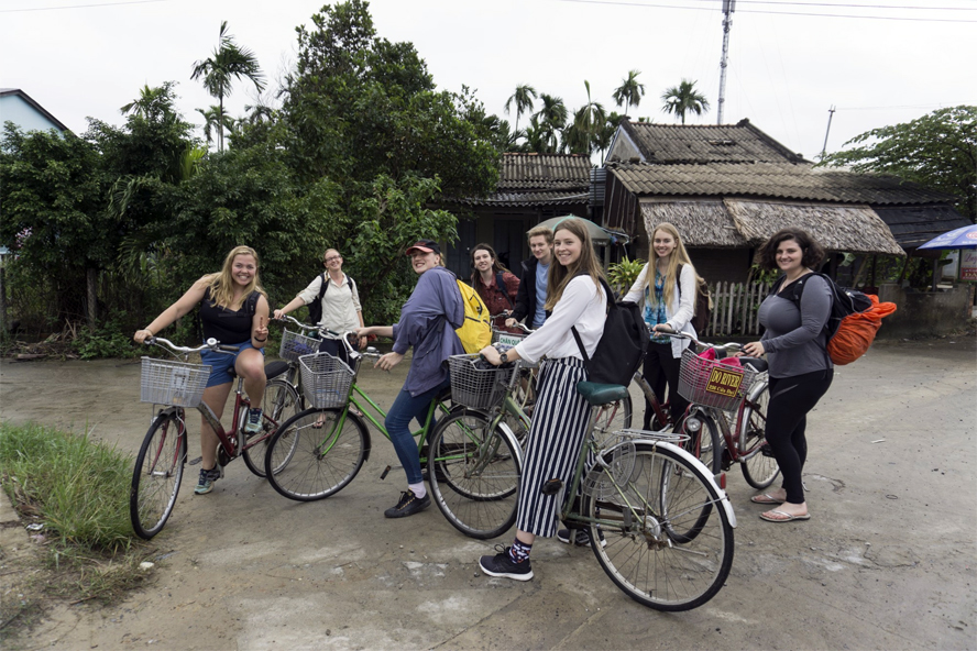 Health and medicine students riding bicycles in Vietname