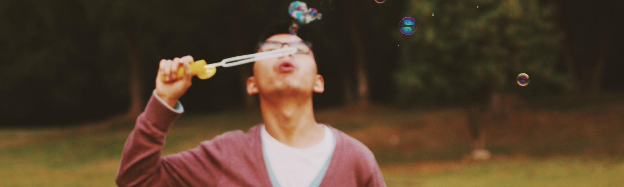 A student blows bubbles towards the sky