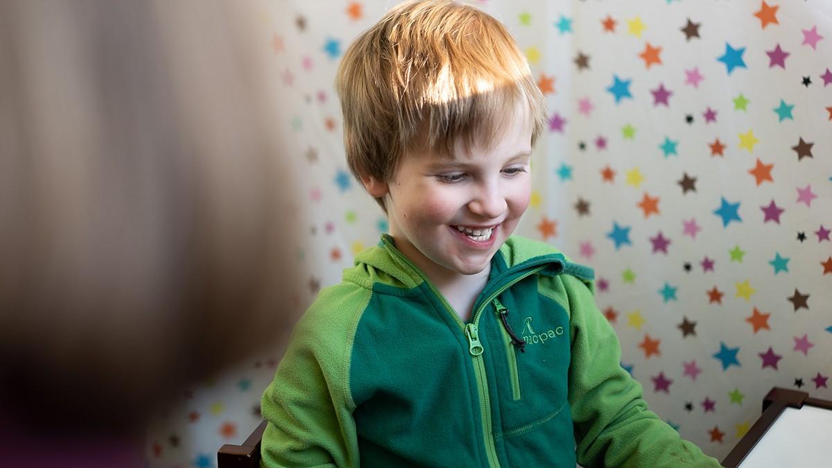 A boy smiling at the ANU Language Lab
