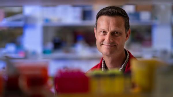 David Tscharke in a medical laboratory